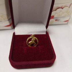 Golden pendant Aries