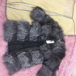 Fur și vulpe de argint pe piele