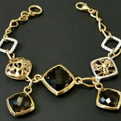 Gold bracelet with rauchtopazy and cubic zirconias