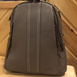 New gray backpack made of genuine leather