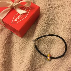 Leather sunlight bracelet with charm in a box