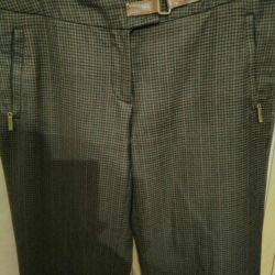 Dark brown trousers, in a cage. The size is 46-48.