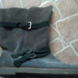 High boots.