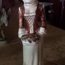 The statuette is old.