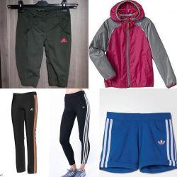 Фірмовий одяг Adidas.