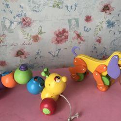 Іграшки каталки на мотузочці