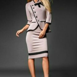 Elegant suit with a beige skirt