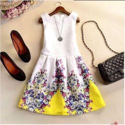 Новое летнее бело-желтое платье с цветами