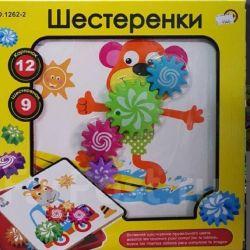 Развивающая игрушка щестеренки