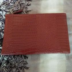 Red clutch made of leather