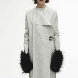 Designer coat with fur on pockets