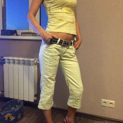Versace T-shirt and breeches.