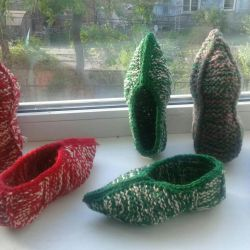 Knitted slippers from wool new