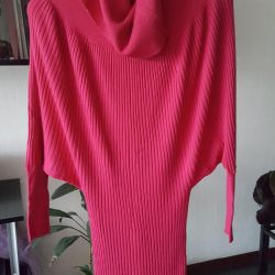 The dress is knitted. New.
