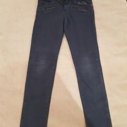 Children's jeans are stretched 128-140