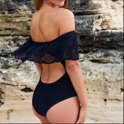 Black swimsuit with a skirt