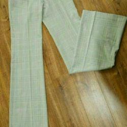 Новые брюки 42 размер
