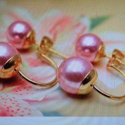 Magnifică bobinele ușoare pe un arc de perle roz