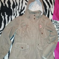 The windbreaker for the girl is new at a height of 110 cm.