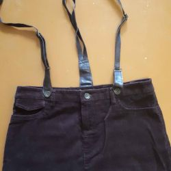 Skirt with leather straps