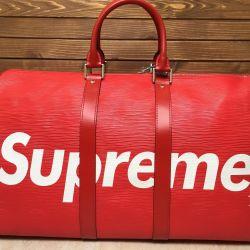 Louie Viton's travel bag supri red