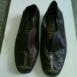 Orthopedic shoes with a massage insole