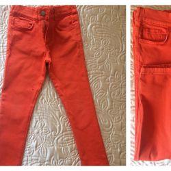 Оранжевые джинсы