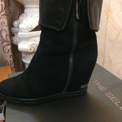 Οι μπότες του πωλητή