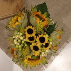 Artificial sunflowers with a vase.