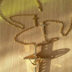 A chain with a cross.