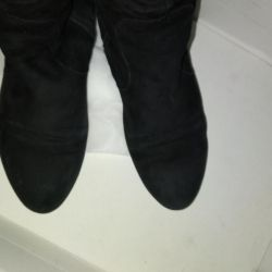 Natural suede boots.