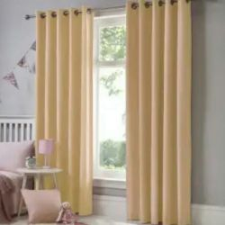 New beige curtains on the grommet