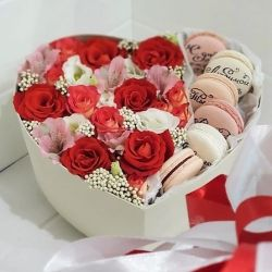 Flowers in boxes with macaroons. Gift box