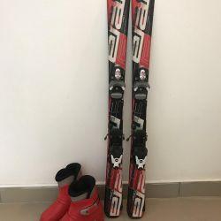 Set of mountain skis, boots, sticks