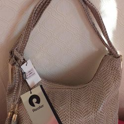 Women bag with a snake print.