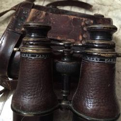 Brass binoculars in a Colmont case