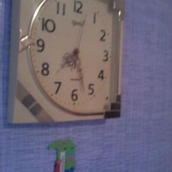 Wall clock with a musical battle