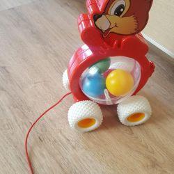 Chipmunk. Toy on a string