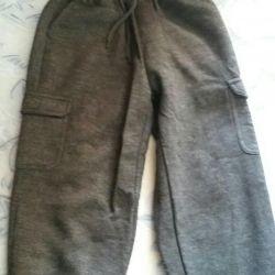 Pantaloni încălțați