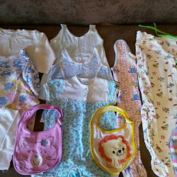 A package of children's clothes from 0 to 8 months.