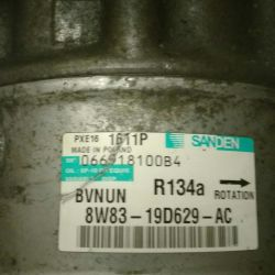 Air conditioning compressor on a LAND ROVER