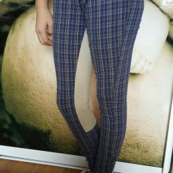 Bir kız için kot pantolon. 165 cm yükseklikte ve 42 çözelti üzerinde