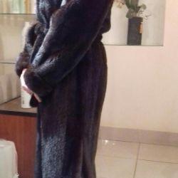 Mink fur coat is long.