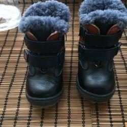 Boots on pavilion