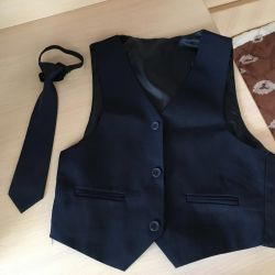 A tie and vest are all for sale all new.