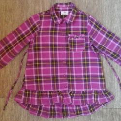 The shirt for the girl the size 110-116