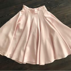 The skirt is gently pink in color