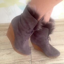 Suede boots on a wooden wedge. Leather