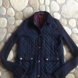 Jacket quilted with knitted sleeves