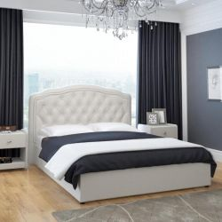 Bed with a soft headboard